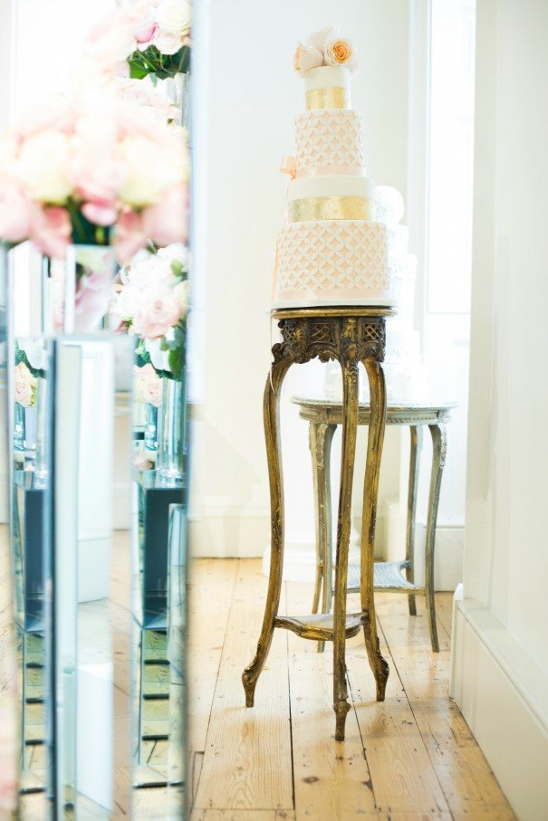 Our gilt pedestals reflected in mirror pedestals as photographed by Henry Curtis-Williams.